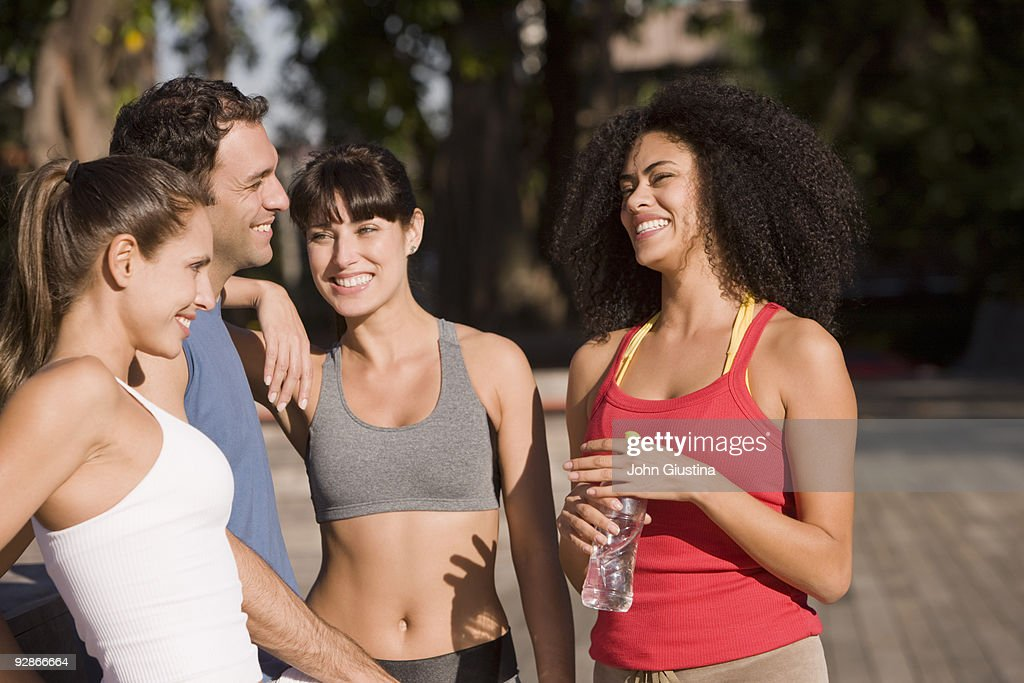 Women and a man Relax after working out. : Stock Photo