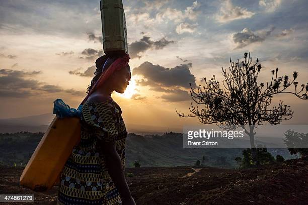 Women and children fetch water from a newly contructed tap system built by the ICCN Congolese Conservation authority on the outskirts of Virunga...