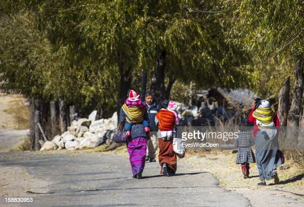 Women and children in traditional Kira dress on the way to the market or shopping near the Temple of Kurjey Lhakhang near Jakar on November 18 2012...