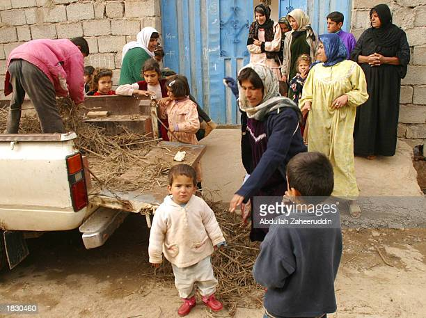 Women and children stand near a small truck March 5 2003 in the village of Kalak Northern Iraq The village of Kalak is located within the Iraqi 'no...