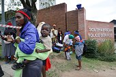 Women and children take refuge at the local Chatsworth police station south of Durban after a xenophobic attack on April 8 2015 Hundreds of people...
