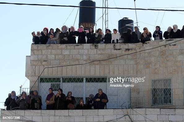 Women and children watch the funeral ceremony of 24yearsold Palestinian Mohammad alJallad in Tulkarm West Bank on February 18 2017 AlJallad were...