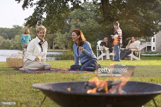Women and extended family by fire pit