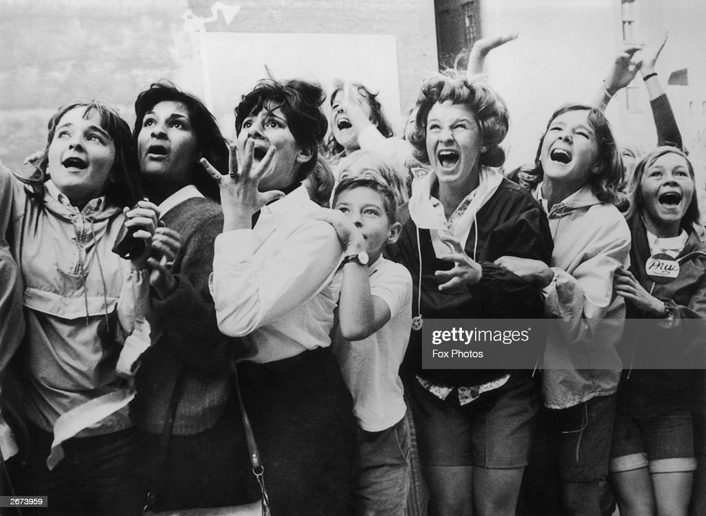Women and girls in Toronto Canada screaming with joy during a visit by the Beatles to their city