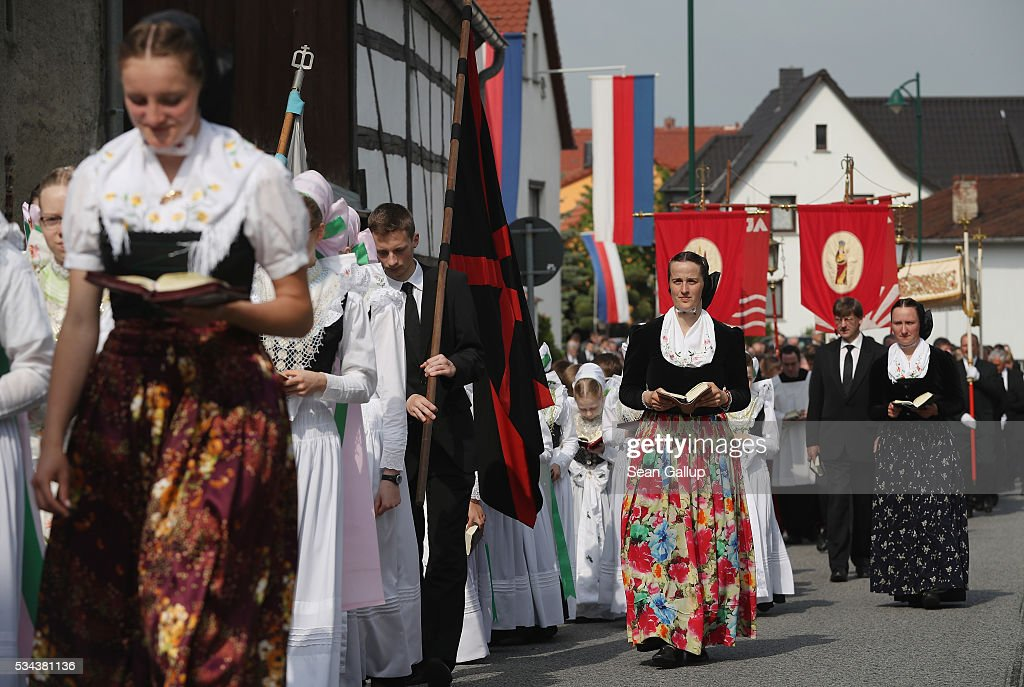 Women and girls wearing traditional Sorbian festive dress participate in the annual Corpus Christi procession through the village center that is adorned with Sorbian flags on May 26, 2016 in Crostwitz, Germany. Sorbians are a Slavic minority in southeastern Germany who speak a language similar to Czech and Polish. Sorbian is still taughet in some schools in the region and a lively tradition of Sorbian literature, theater and folk culture has survived.