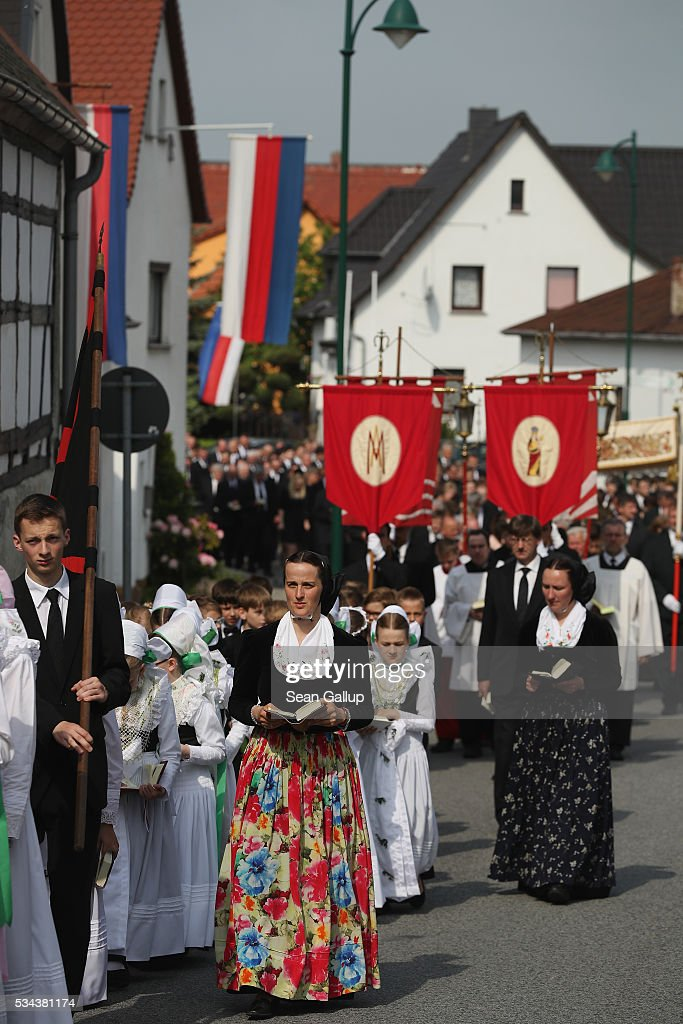 Women and girls wearing traditional Sorbian festive dress participate in the annual Sorbian Corpus Christi procession through the village center that is adorned with Sorbian flags on May 26, 2016 in Crostwitz, Germany. Sorbians are a Slavic minority in southeastern Germany who speak a language similar to Czech and Polish. Sorbian is still taughet in some schools in the region and a lively tradition of Sorbian literature, theater and folk culture has survived.