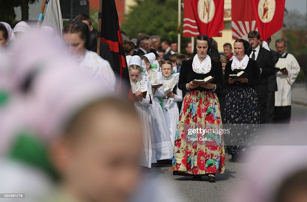 Women and girls wearing traditional Sorbian festive dress participate in the annual Sorbian Corpus Christi procession through the village center on May 26, 2016 in Crostwitz, Germany. Sorbians are a Slavic minority in southeastern Germany who speak a language similar to Czech and Polish. Sorbian is still taughet in some schools in the region and a lively tradition of Sorbian literature, theater and folk culture has survived.