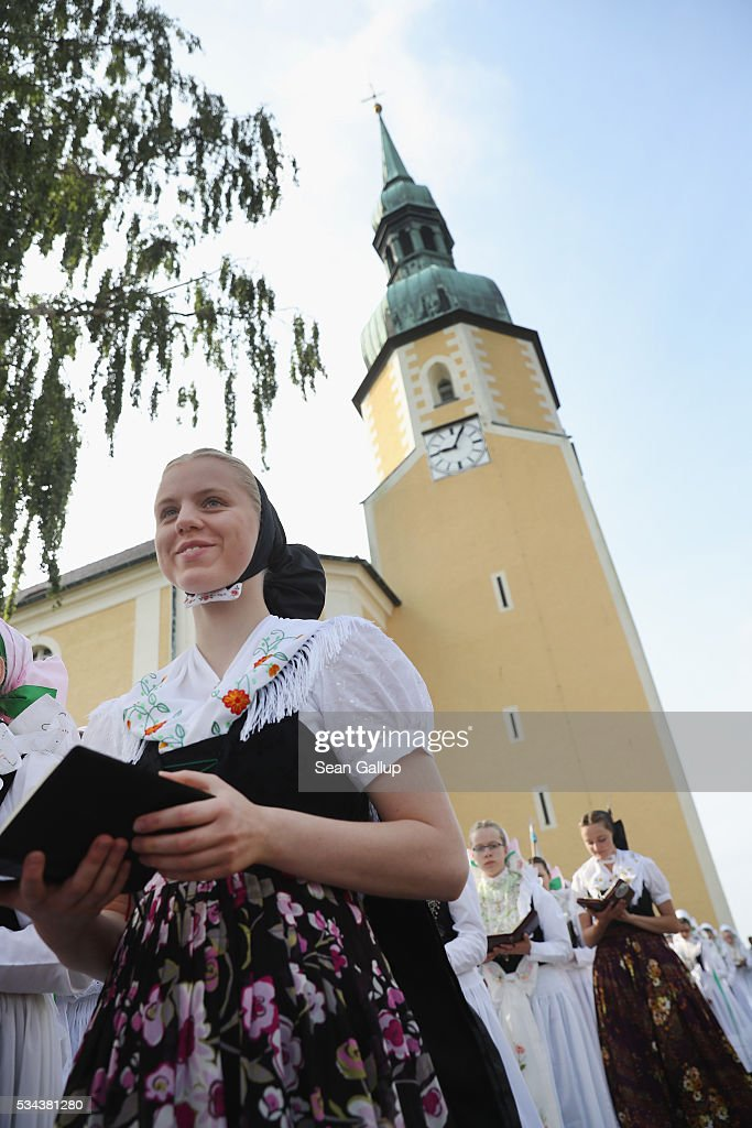 Women and girls wearing traditional Sorbian festive dress participate in the annual Sorbian Corpus Christi procession as they emerge from mass in the village church on May 26, 2016 in Crostwitz, Germany. Sorbians are a Slavic minority in southeastern Germany who speak a language similar to Czech and Polish. Sorbian is still taughet in some schools in the region and a lively tradition of Sorbian literature, theater and folk culture has survived.