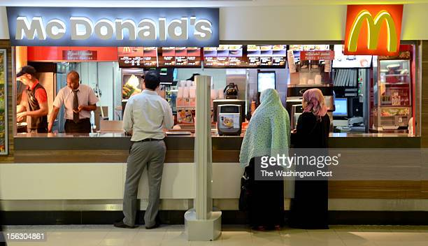 Women and men are segregated by a movable barricade in ordering food at Kingdom Centre Mall in Riyadh Saudi Arabia on October 2 2012 In Saudi Arabia...