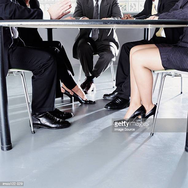 Women and men at a meeting room