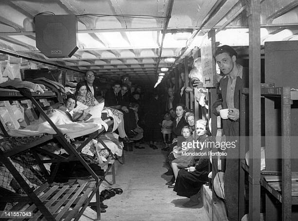 Women and men in an antiaircraft shelter London July 1944