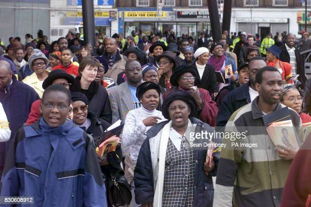 Women and men singing during the march in south London in support of Damilola Taylor who was murdered in Peckham *Several churches in Damilola's...
