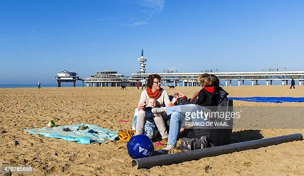 Women and their children enjoy a sunny day on the Scheveningen beach on March 5 2014 Spring like weather is expected in the country for the next week...
