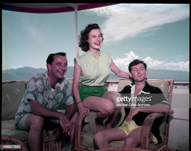 A women and two men ride on a boat in Acapulco Mexico in July 1953