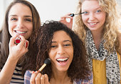 Women applying makeup together