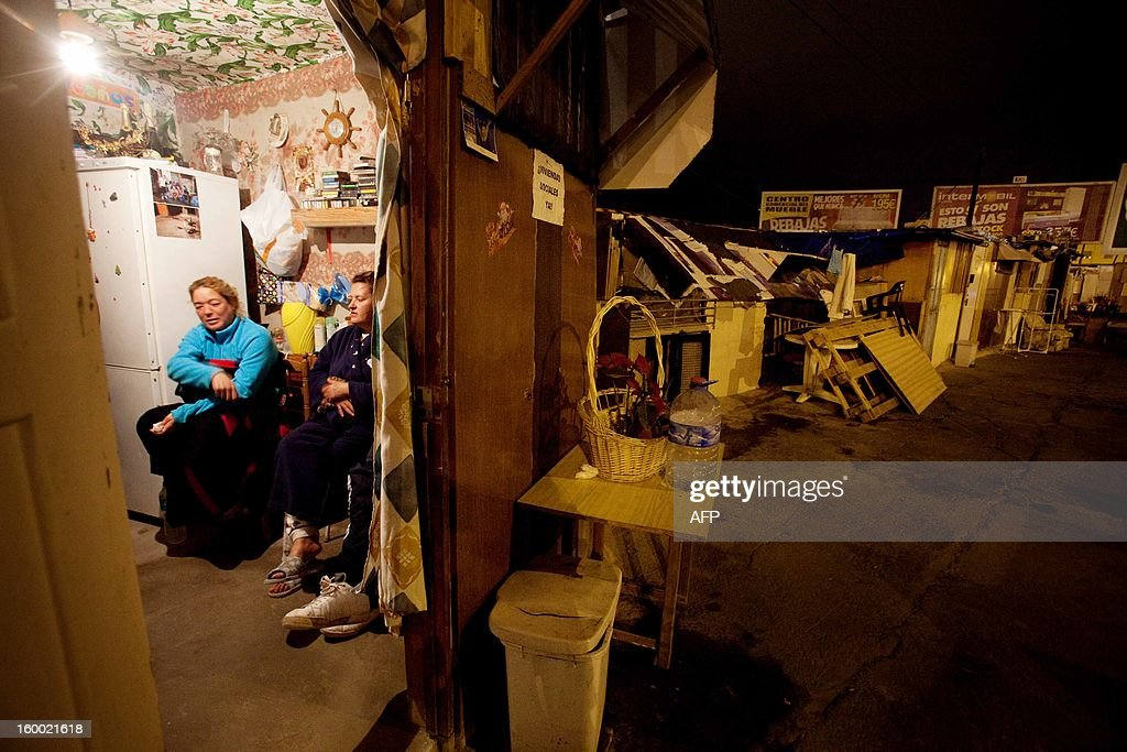 Women are pictured in a slum on January 23, 2013 in Santa Cruz de Tenerife on the Spanish Canary Island of Tenerife. Spain's unemployment rate surged to a modern-day record of 26.02 percent in the final quarter of 2012 as nearly six million people searched in vain for work in a biting recession, official data showed on January 24, 2013.