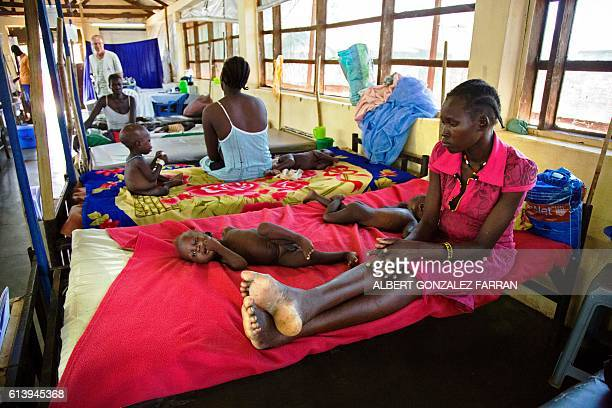Women are pictured with their malnourished children at the clinic run by Doctors without Borders in Aweil Northern Bahr al Ghazal South Sudan on...