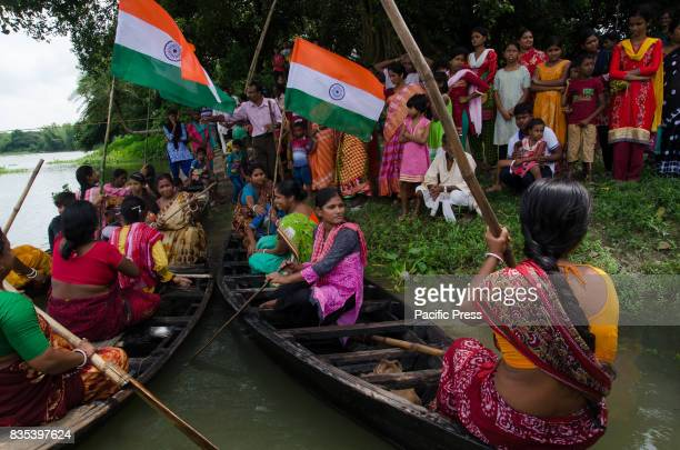 Women are preparing themselves for the boat race on 71st Independence day in Shivniwas village