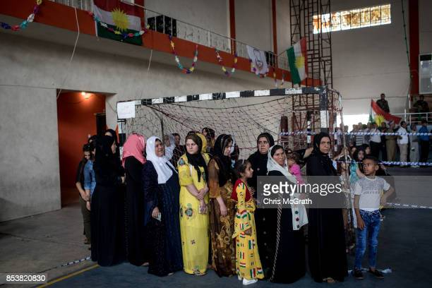 Women are seen waiting in line to cast their referendum vote at a voting station on September 25 2017 in Erbil Iraq Despite strong objection from...