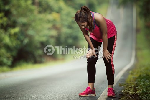 Women are tired From jogging on a steep slope : Stock Photo