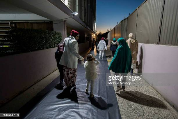 Women arrive for pre dawn prayers before worshipers flock to the Lakemba Mosque in suburban Sydney Australia Crowds spill into the street and...