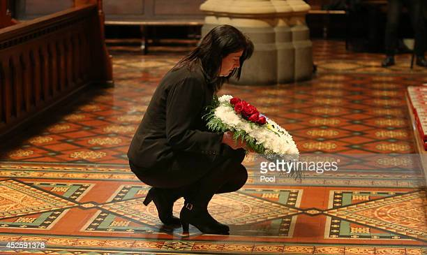 A women arrives with a wreath of flowers at a Multifaith memorial service held for victims of the MH17 disaster at St Paul's Cathedral on July 24...