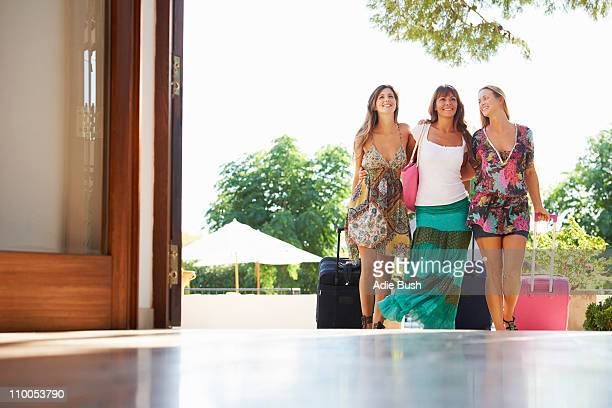 Women arriving at hotel with suitcases