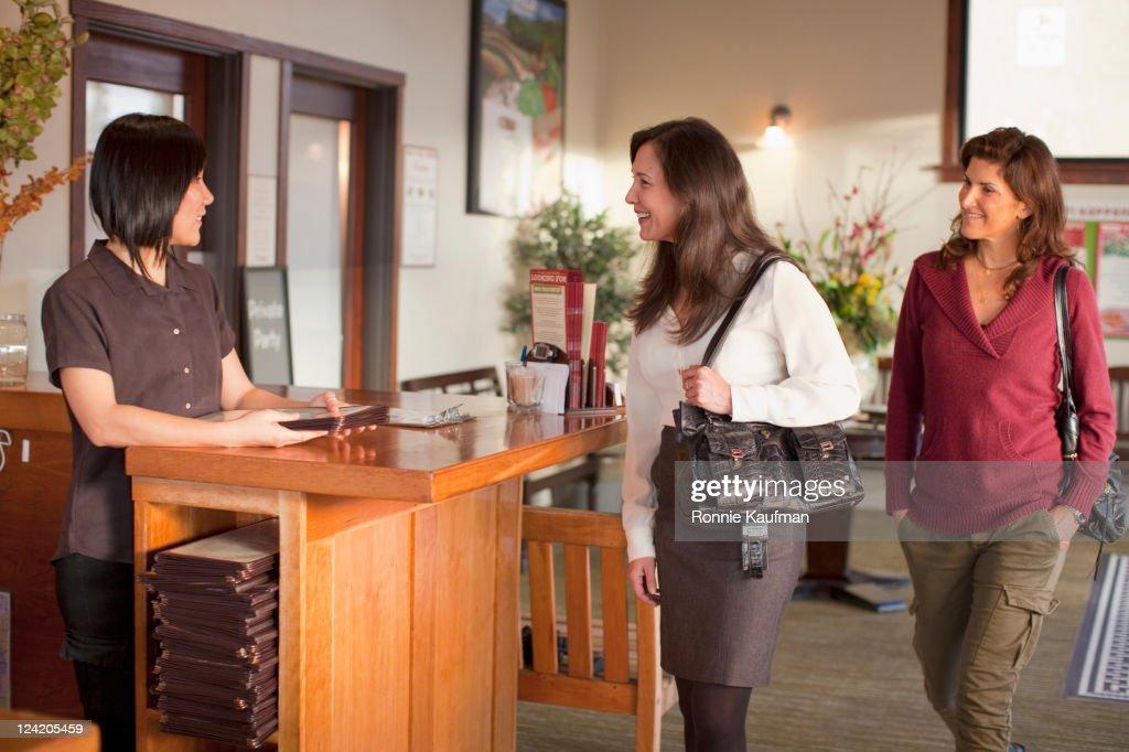 Women arriving in restaurant