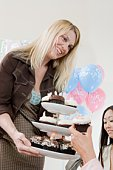 Women at a Baby Shower with Cupcakes