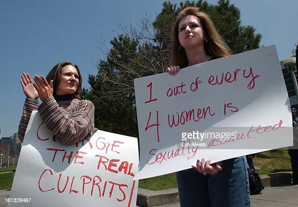 Women at a rally on the Auraria campus hold protest and political signs Metro policical science instructor Barbara Traudt addressed the 1 pm crowd...