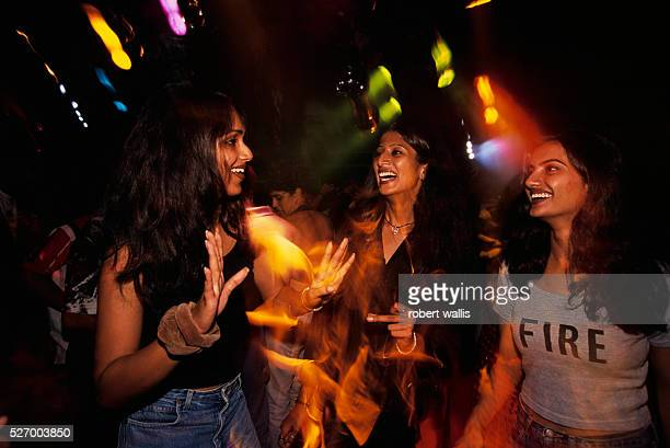 Women at a rave party produced by MTV and Kingfisher beer in a Bangalore warehouse