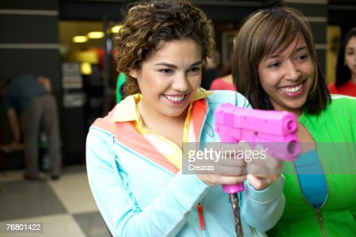 Women at a video arcade : Stock Photo
