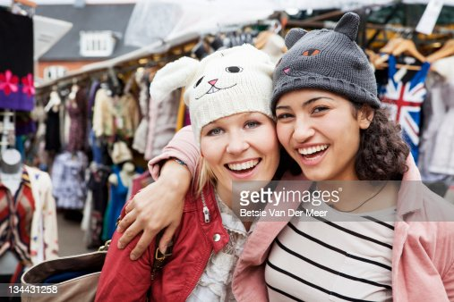 Women at clothes market wearing animal hats. : Stock Photo