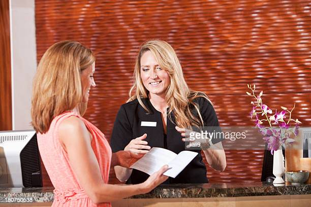 Women at hotel reception desk