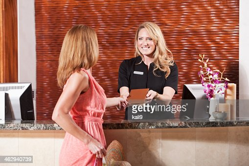 Women at hotel reception desk