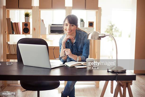Women at modern home office.
