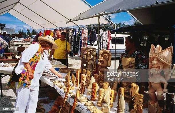 Women at souvenir stand.