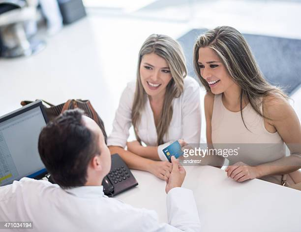 Women at the hair salon paying by card