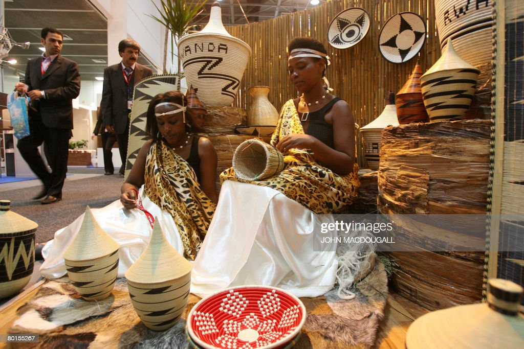 Women at the Rwanda stand demonstrates traditional weaving techniques during the ITB trade fair in Berlin on March 7 2008 From March 5 to 9 more than...