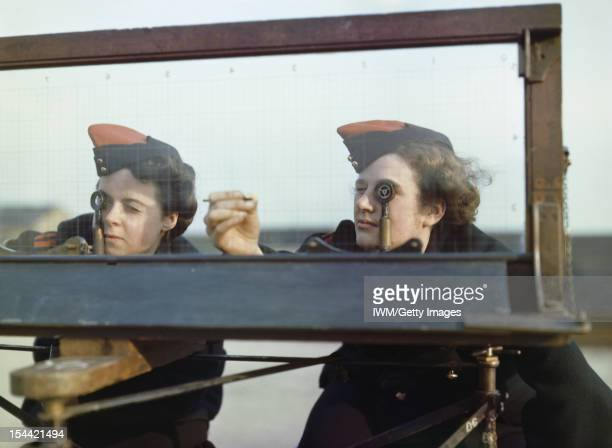 Women At War 1939 1945 Auxiliary Territorial Service Two ATS girls at the Royal Artillery Experimental Unit Shoeburyness Essex using the Window...