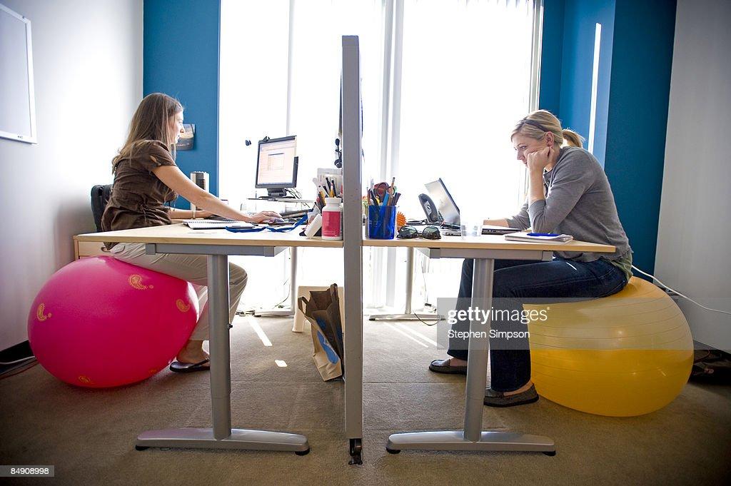 women at work on exercise balls : Stock Photo