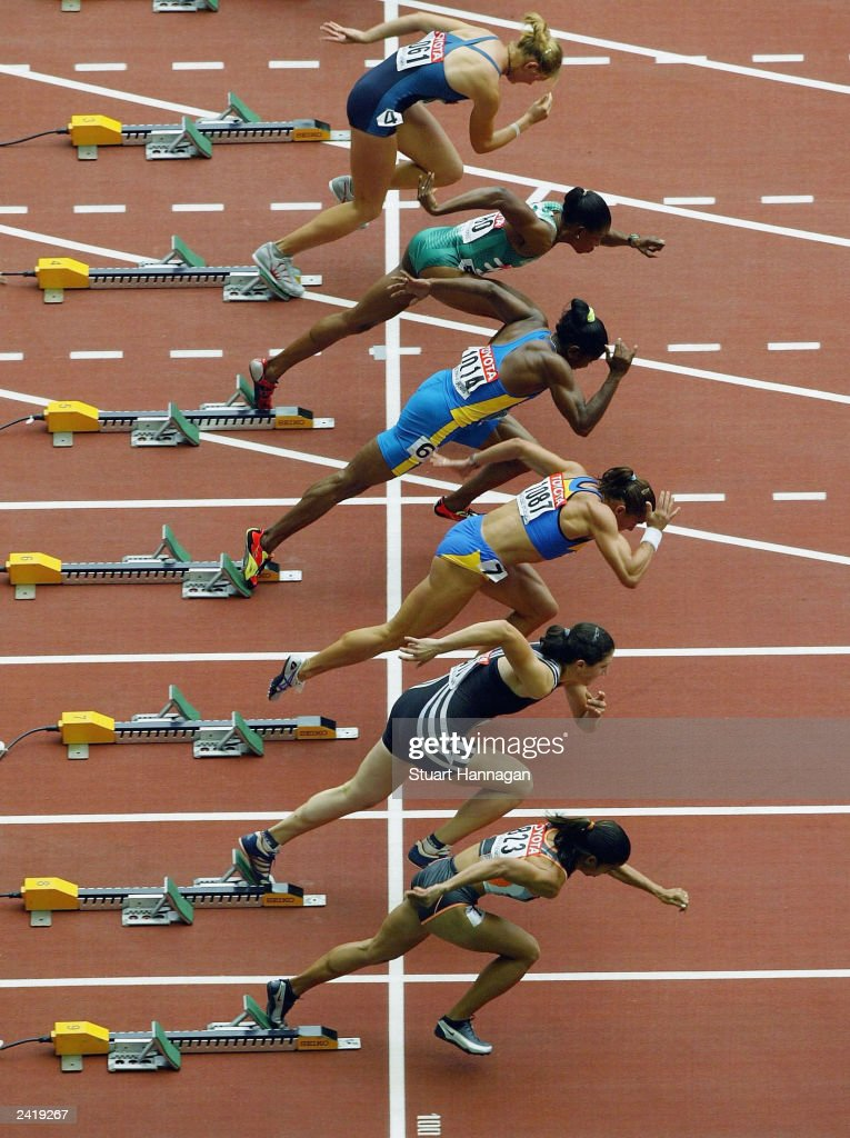 Women athletes takes off from the starting blocks during the first round of the women's 100m heats at the 9th IAAF World Athletics Championship August 23, 2003 in Paris.