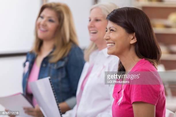 Women attend a breast cancer awareness seminar