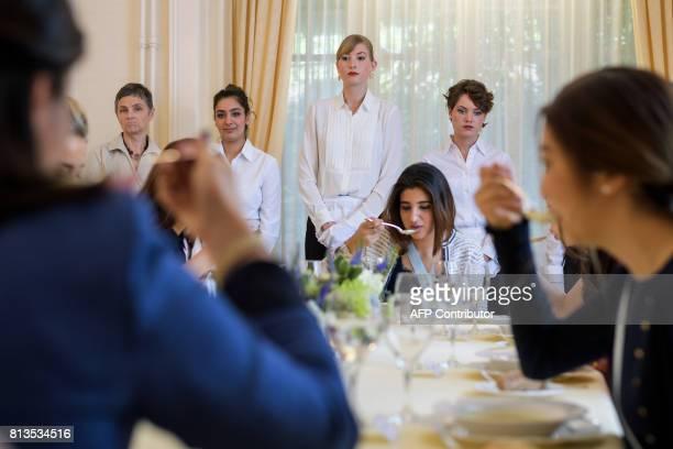 Women attend a lesson at the Switzerland's last finishing school Institut Villa Pierrefeu on June 26 2017 in Glion Eight women sit primly around an...
