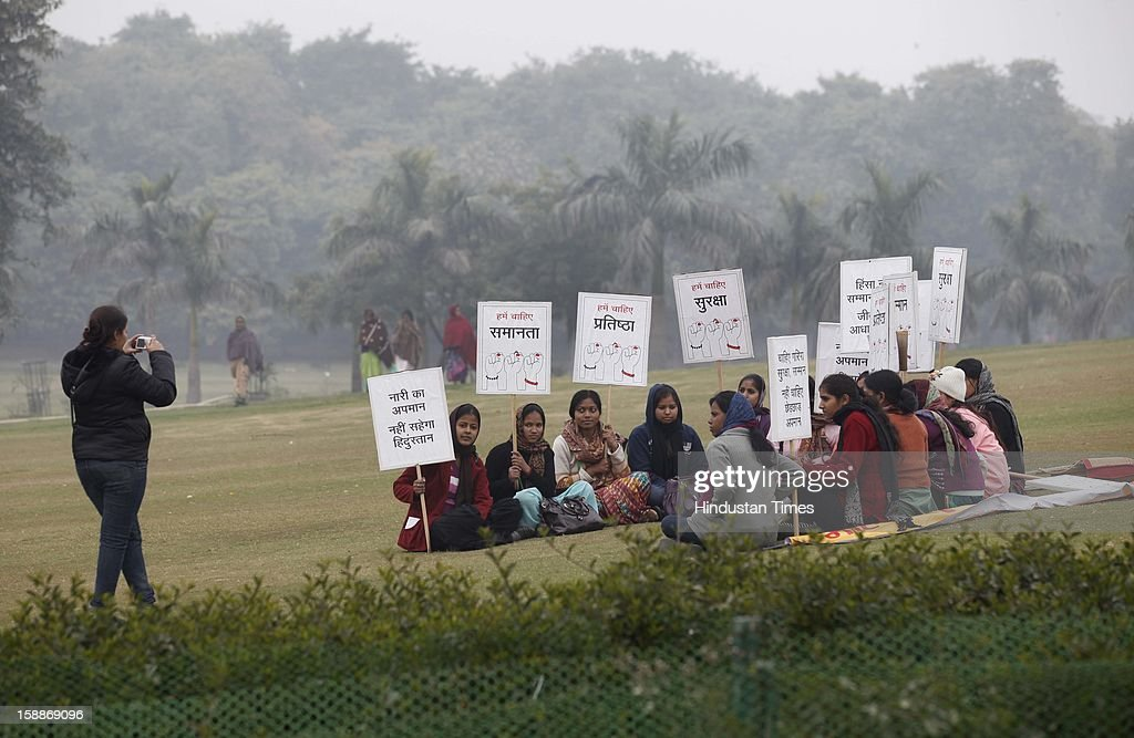 Women attend a prayer ceremony for a rape victim after a rally, organized by Delhi Chief Minister Sheila Dikshit (unseen), protesting for justice and security for women at Raj Ghat on January 2, 2013 in New Delhi, India. Dikshit flagged off the 'Mahila Suraksha Samman March' from Bal Bhavan to Rajghat which was participated by over a thousand women.