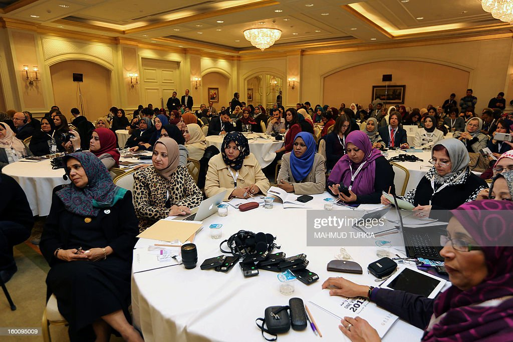 Women attend the opening meeting of the second annual 'One Voice 2013' conference on January 26, 2013 in the Libyan capital Tripoli. The event focuses quite strongly on the role of women in the Libyan Constitution and in Security and gathers over 150 selected civil society activists from over 25 cities and takes place until January 28, 2013. AFP PHOTO/MAHMUD TURKIA