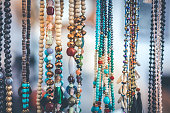 Women beads and necklace in jewerly market. Bali island. Asia.