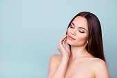 Women beauty and health, wellbeing concept. Young pretty brunette lady is touching gently her attractive healthy smooth skin