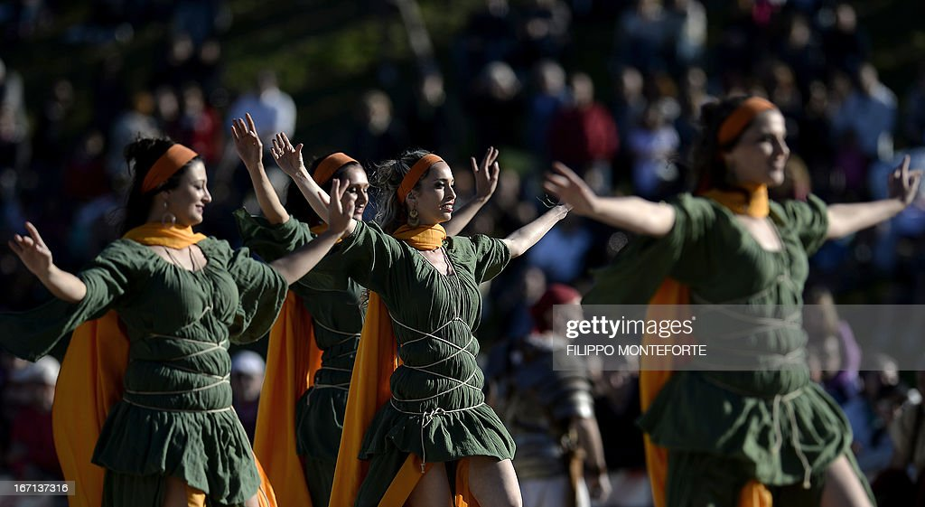 Women belonging to historical groups dance dressed as ancient Romans during a show to mark the anniversary of the legendary foundation of the eternal city in 753 B.C, in Rome's Circo Massimo on April 21, 2013. AFP PHOTO / Filippo MONTEFORTE