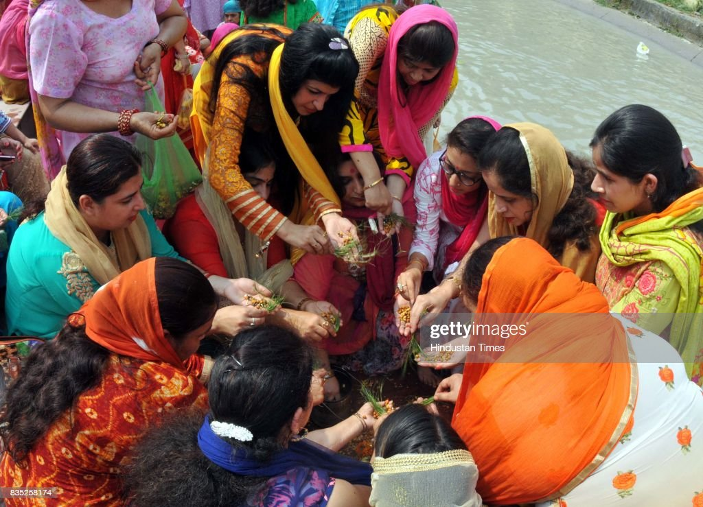 Women belonging to the Dogra community praying for the long life of their sons during the 'Bacch Dua' festival, on August 18, 2017 in Jammu, India.